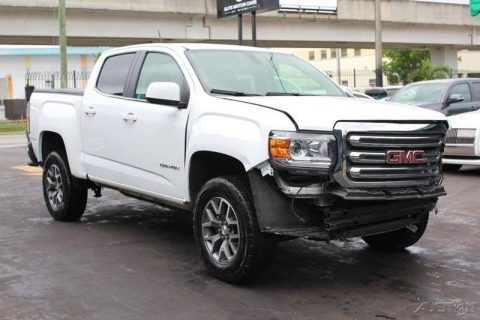 loaded and damaged 2016 GMC Canyon SLE Crew Cab for sale