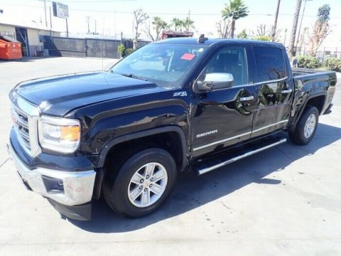 damaged 2015 GMC Sierra 1500 SLT Crew Cab for sale